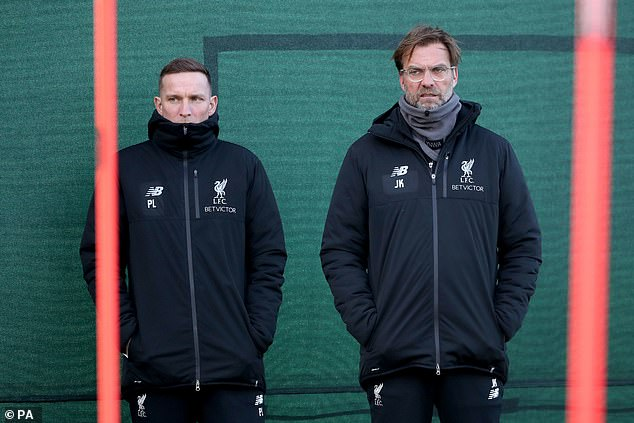 Jurgen Klopp's (right) right-hand man Lijnders (left) has said that Minamino has promise