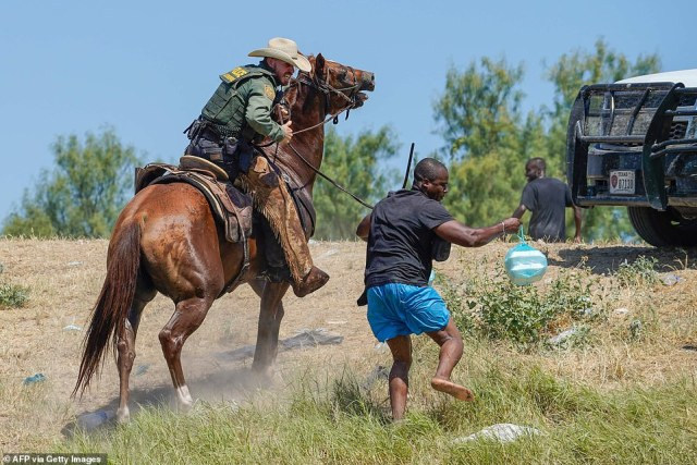 Images of agents using whips on horses were captures as migrants attempted to return to their makeshift camp from Mexico, where they were buying supplies