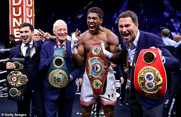 Hearn and Joshua are pictured celebrating after AJ beat Andy Ruiz Jr at 'Clash on the Dunes'