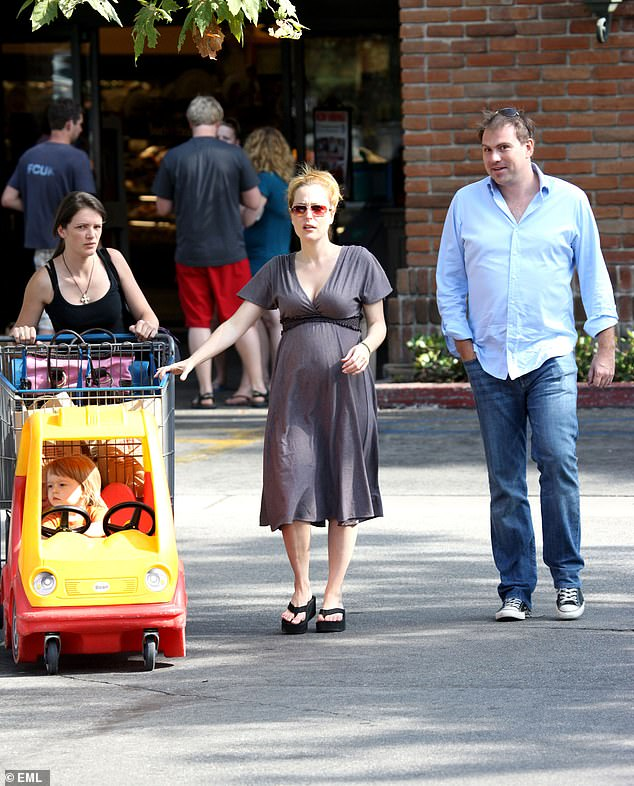 Mother of three: Gillian also has two teenage sons — Oscar, 14, and Felix, 12 — with ex Mark Griffith.  She is pictured with Oscar and Mark while pregnant with Felix in 2008