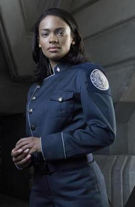The uniform's blue color, diagonal silver buttons and white trim are all reminiscent of the uniform worn by officers on classic sci-fi show Battlestar Galactica.