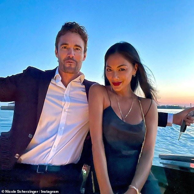 Loved-up: The pop star enjoys some free time with Thom and they pose for a sunset snap as they enjoy an evening