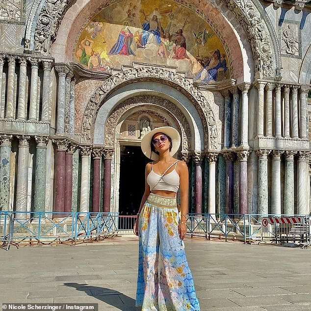 Born to Explore: Tara looked stunning as she enjoyed some of Venice's distinctive architecture