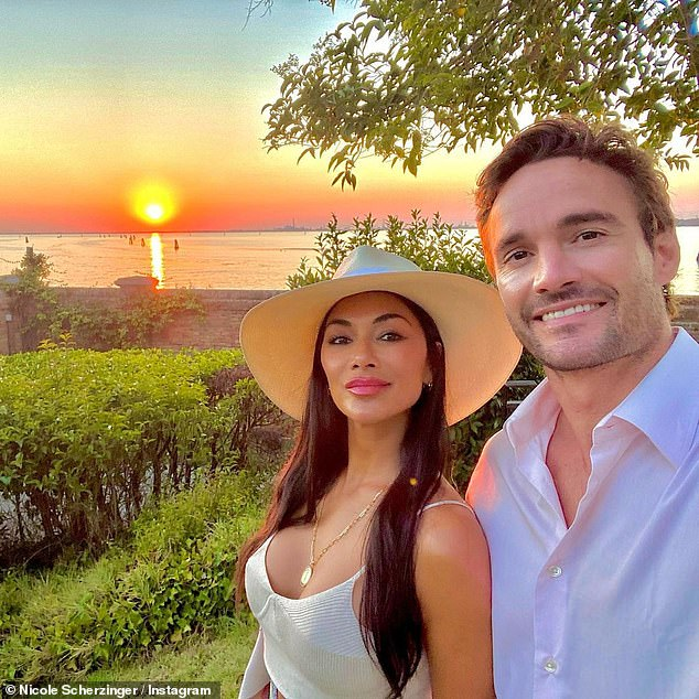 CUTE: The star leaned in for a kiss with the 35-year-old rugby player as they enjoyed a picturesque sunset in the snaps