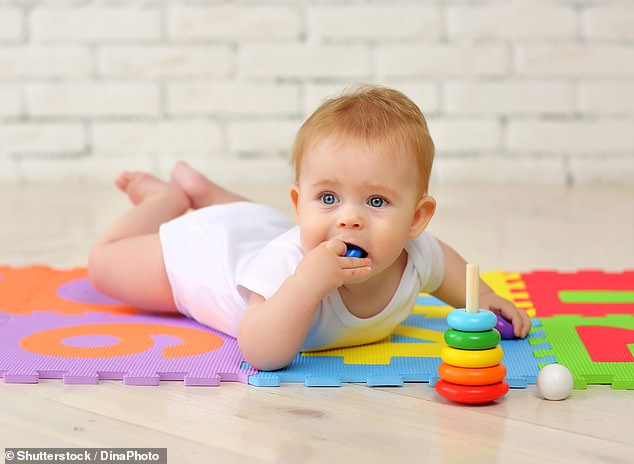 Babies have 10 times more microplastic in their stool than adults, a new study warns (stock image)