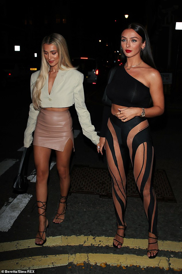 Bombshell: Kadi turned up the temperature in her sheer leggings that covered her body in bold black stripes and left little to the imagination