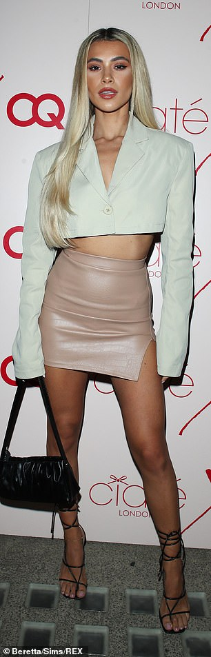 Wow: Joanna Chimonidis showed a glimpse of her messy belly in a mint-cropped blazer at Christine Quinn's Ceat x CQ launch party in London Wednesday night