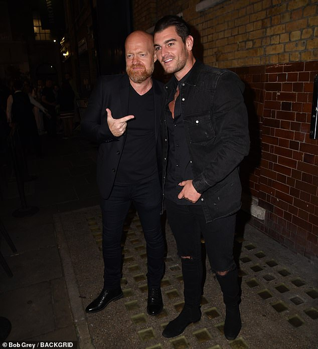 Friendly: Jake rocked a dapper figure in a black suit as he drove home from the theater before bumping into former EastEnders co-star Matt Lapinskas.