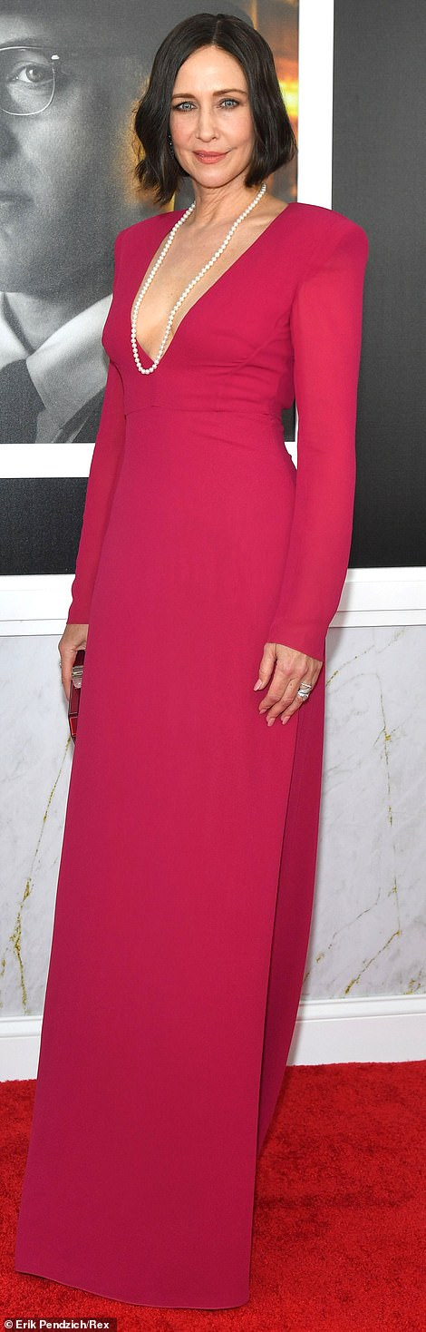 Stunning: Vera Farmiga took the plunge in a stunning floor-length fuchsia gown, which she accessorized with a single strand of pearls