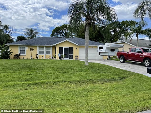 A DailyMail.com image taken on September 13 shows the Laundrie's camper in their driveway. Neighbors said they hooked it up to the red pickup truck in front of it for a weekend camping trip on September 11 - the day Gabby was reported missing