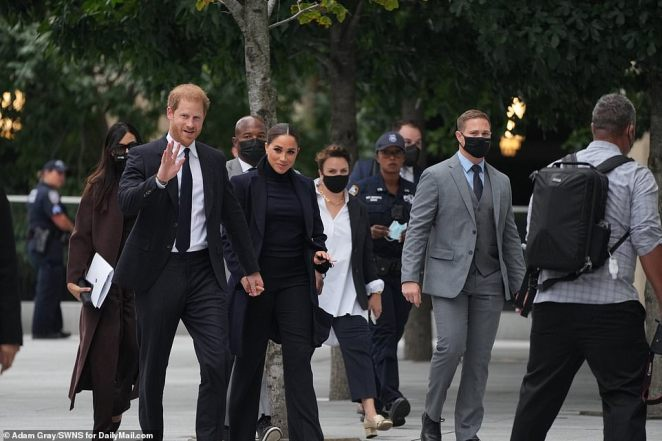 Harry gave a wave to fans who called his name as he and Meghan walked towards the entrance of the skyscraper