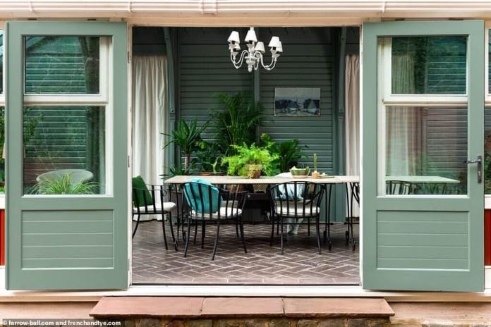 A lick of green sage — and lots of lush plants — has changed the way a home looks for the dining room.