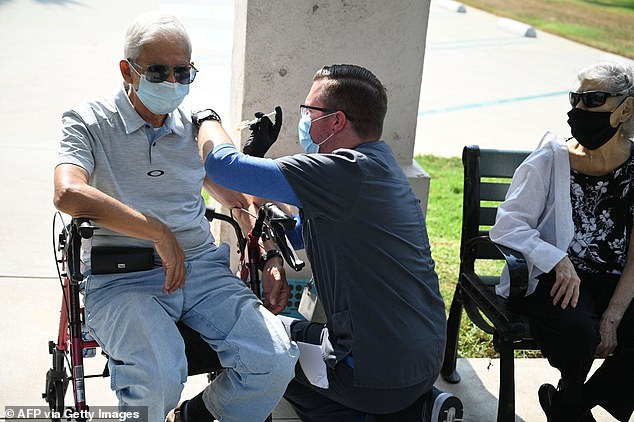 CDC's advisory committee has voted to recommend the booster for use in people age 65 and older and those aged 50 to 64 with underlying medical conditions.  Pictured: Nurse Kevin Grellman gives 80-year-old Jose Gomez, 80, a third booster dose of Pfizer's vaccine after his wife.  Armida Gomez, 81, welcomes her in August 2021 in Pasadena, California