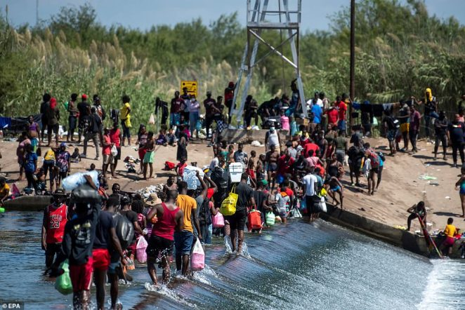 Migrants wait on the Rio Grande to cross to the United States, in Ciudad Acuna, Coahuila state, Mexico on September 18