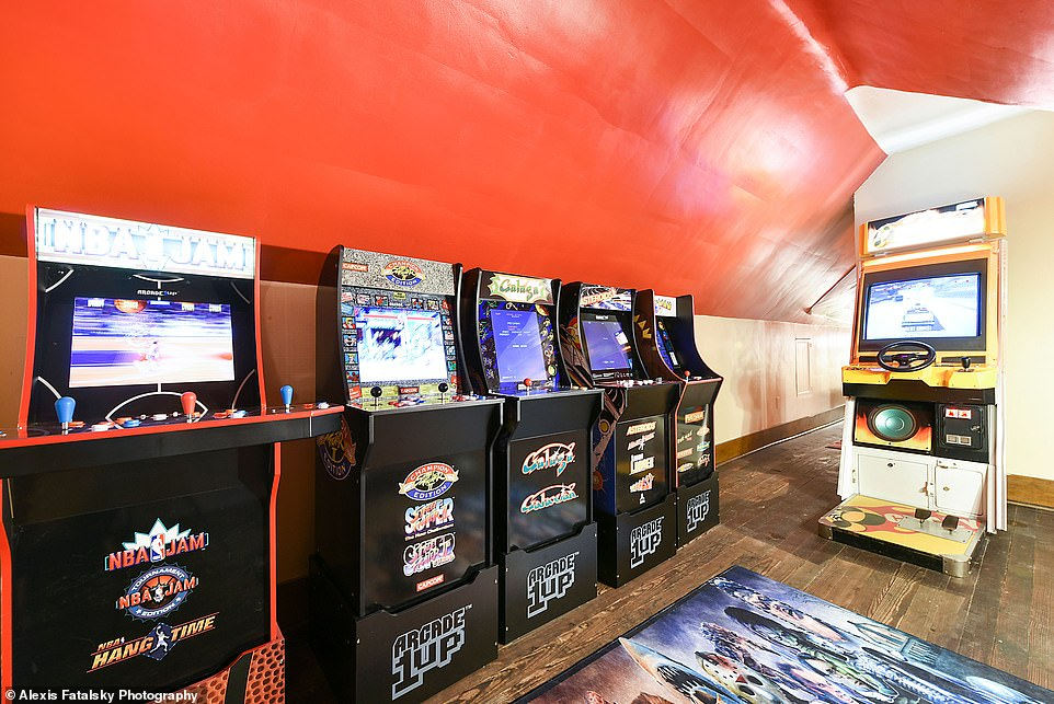 Have fun: The attic has been turned into 'Buffalo Bill's Playhouse,' a retro-inspired game room featuring classic arcade video games