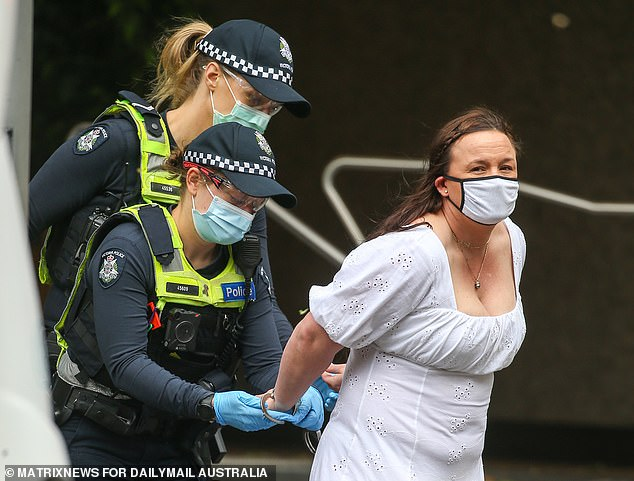 In disturbing scenes, Victoria Police pounced on anyone who entered the Bourke Street Mall on Friday to quiz them about why they were there. Pictured: A woman is arrested