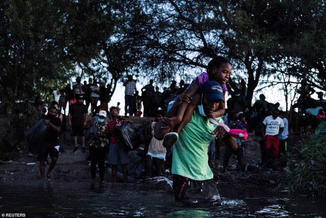 Migrants seeking asylum in the U.S. cross the Rio Grande river into the U.S. after leaving a makeshift migrant camp