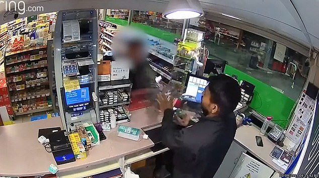 A 34-year-old man has been arrested after police received reports of racial abuse (pictured: CCTV footage of incident) at Texaco Garage in Accrington, Lancashire, on Monday morning