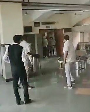 Footage from the courtroom shows people fleeing as loud gunshots ring out causing chaos