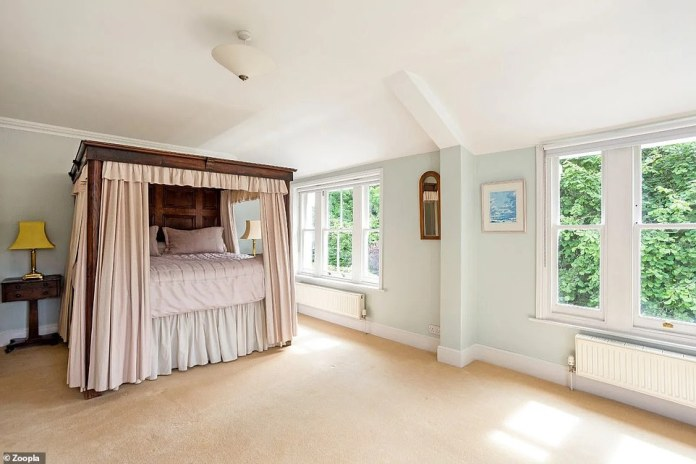 The Victorian home has five bedrooms, with this large one with room for a four-poster bed that overlooks the garden