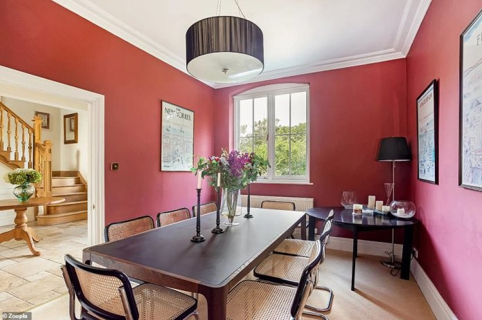 The large dining room leads to the property's main entrance and is painted dark
