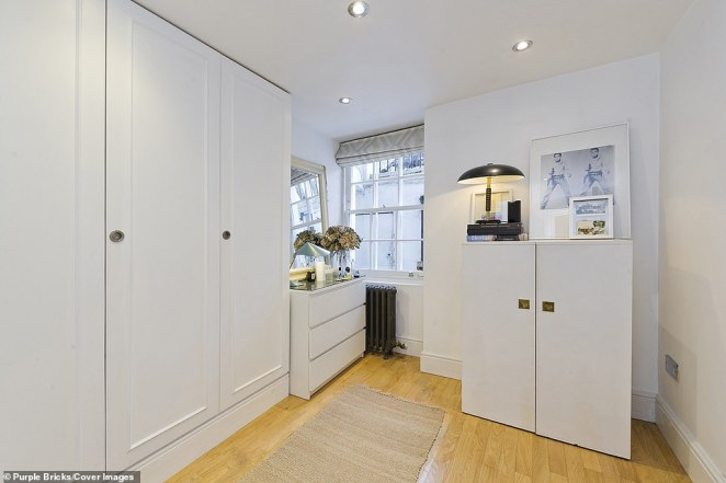 One of the bedrooms boasts ample wardrobe and storage space - despite fitting within the 53.9sqm home