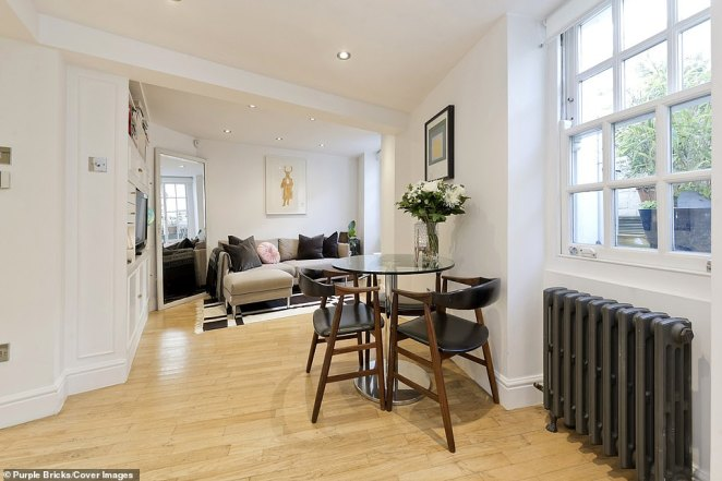 The surprisingly spacious property is listed on Purple Bricks for £795,000 (Pictured: Living room area)