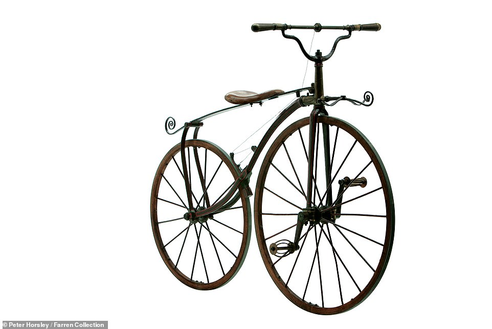 This is an 1869 'Boneshaker', 'a particularly fine example, with cast bronze head and pedals' and ornamental flourishes. Mr Farren revealed: 'This type of machine with wooden wheels and metal tyres, was invented by Pierre and Ernest Michaux in 1863, who named it the velocipede. They are regarded by some as the first true bicycles. The single rear brake was operated by twisting the handlebars. These machines were popular through the 1860s but, as the name suggests, they were uncomfortable to ride, heavy and under-geared'