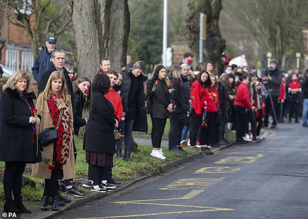 People line the road to watch the funeral procession of Olly Stephens in Reading in February