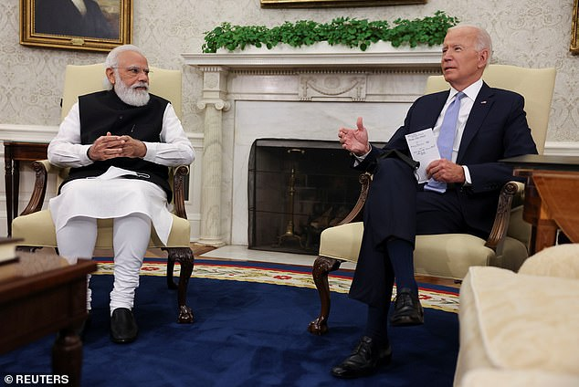 President Joe Biden (right) meets with Prime Minister Narendra Modi (left) in the Oval Office on Friday. He'll host his first Quad meeting today that will also include the leaders of Japan and Australia