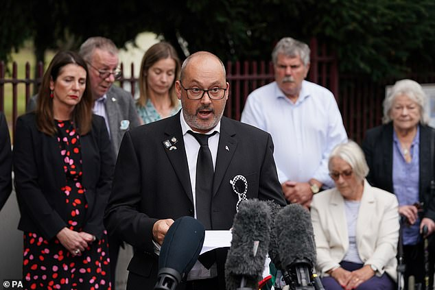 Stuart Stephens, the father of Olly Stephens, reads a statement outside Reading Crown Court