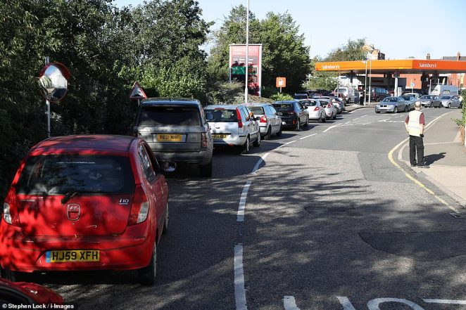 Frenzied buying has caused flare ups at gridlocked filling stations today (pictured in Tonbridge) as motorists ignored Government pleas for calm