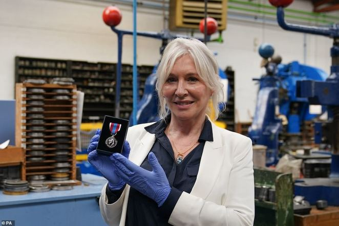 Culture Secretary Nadine Dorries during a visit to the Worcestershire Medal Service factory in Birmingham where the Queen's Platinum Jubilee Medal is being produced