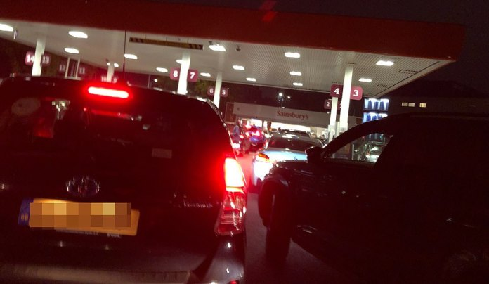 Drivers queued throughout the night to fill their cars with petrol. Pictured, queues at Sainsbury's Alperton petrol station at 5:45am as the issue continued