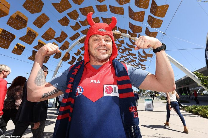 This colourful Demons die-hard hopes his club can win their first AFL premiership since 1964