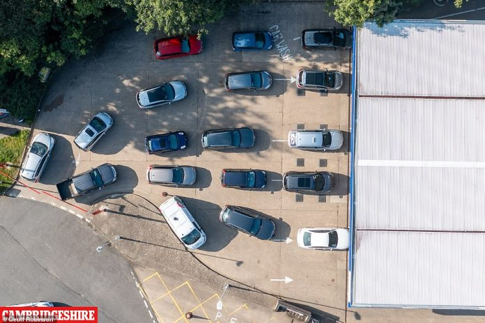 ELY: CAMBRIDGESHIRE: An aerial view of the queue of cars outside a Tesco petrol station in Ely, Cambridgeshire on Friday, as panic buying begins despite the Government saying there is 'no shortage of fuel in the UK'