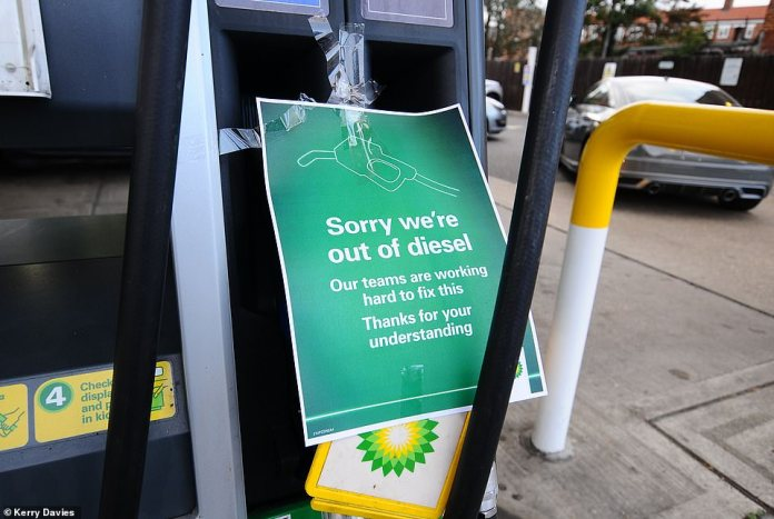 A BP at Hampton Court says 'Sorry we're out of diesel' after frenzied buying saw stations swamped by panicked customers