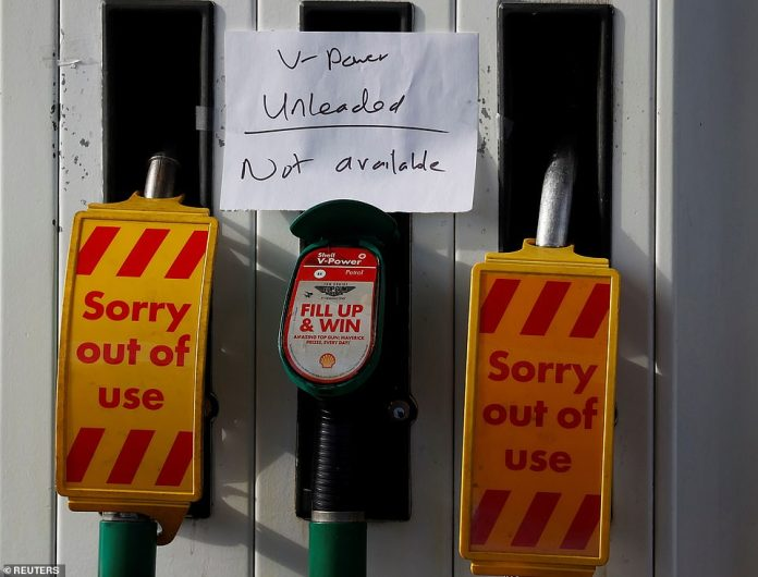 Many forecourts in London and other cities were closed or running low on both unleaded and diesel (pictured, handwritten signs warning there was no fuel available at a station in Manchester)