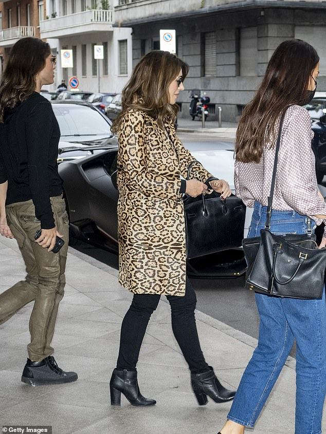 Out: The actress cut an elegant figure as she left her hotel for Fashion Week in the city with her model son Damian, 19, who wore a black top and brown leather pants
