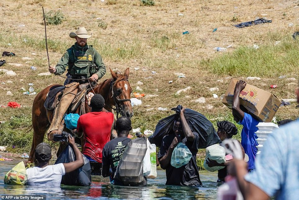 Paul Ratje, the New Mexico-based photographer who took the image said the riders were merely swinging their reins, not trying to harm the migrants