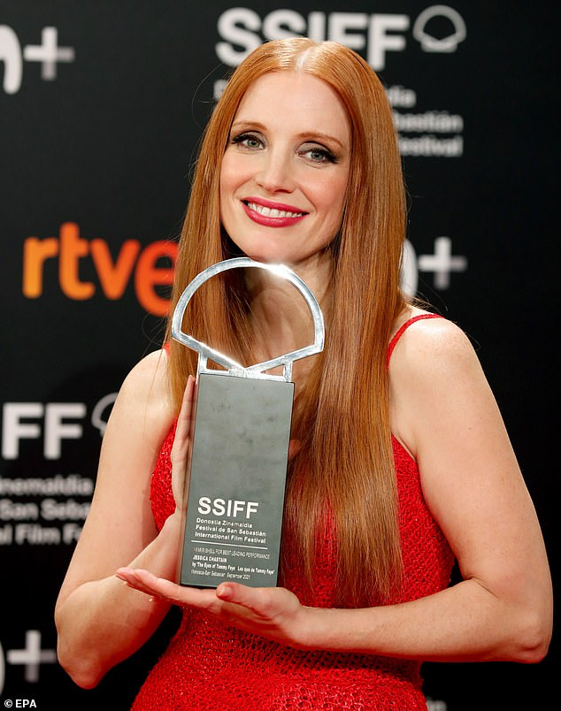 Proud: The actress won the gong for her performance as Tammy Faye Bakker in the film The Eyes of Tammy Faye