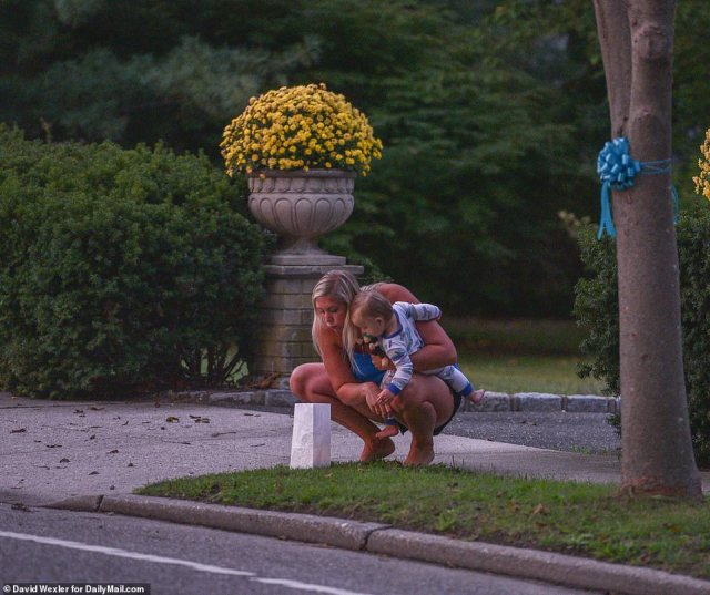 One resident set up a candle outside outside her driveway to show solidarity for their late neighbor