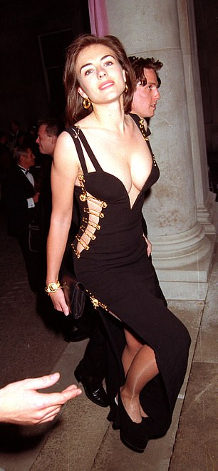 Fashionistas said Dua's dress was a tribute to the Versace gown worn by a then-unknown Ms Hurley when she accompanied boyfriend Hugh Grant to the premiere of Four Weddings And A Funeral in London in 1994 (pictured)