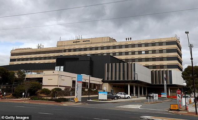 Health officials are calling for the premier to be honest about a 'health system already in crisis' as the reopening of borders will bring new cases to the region (pictured, Modbury Hospital in Adelaide)