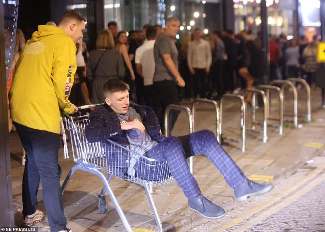 Trolleyed: Thousands of revellers descended onto the streets of Leeds as they marked the end of their first week as Freshers