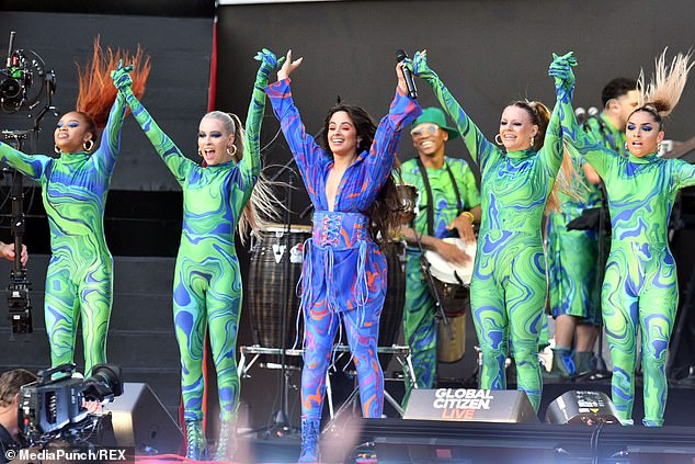 Chart Topper: The Cuban-born singer opened her set with her hit single Havana, featuring a bevy of backup dancers in identically designed bodysuits with blue and green swirls.