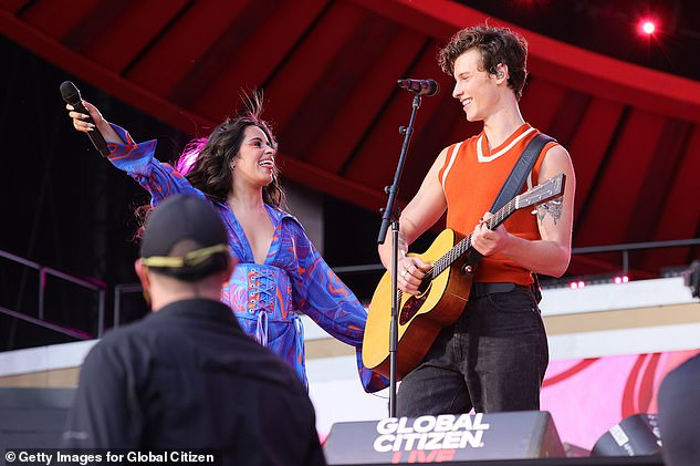 The Involvement: Camilla leans into a romance with her next song as her boyfriend Shawn Mendes takes the stage.  He wore an orange sweater vest with white trim, as well as a simple set of black jeans.  He was strumming on his acoustic guitar while he and his love took on the vocals