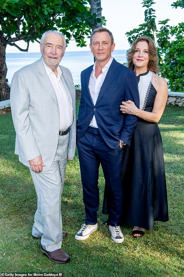A Family Affair: 'I'm kind of in denial, I just want Daniels to last forever,' she said.  'So I ain't thinking about it [his replacement].  it's something michael [G Wilson, her half-brother and fellow producer] And I'll discuss next year' [the three are pictured in Jamaica in 2019]