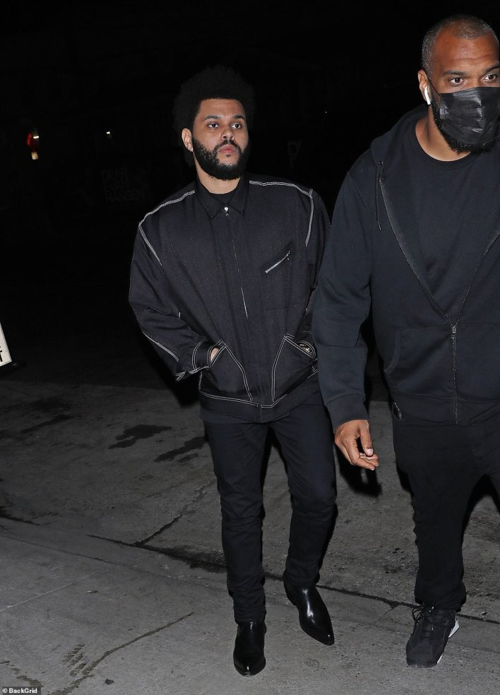 Twinning: The Weeknd - who relies stylist Matthew Henson - coordinated with her in a black jacket, skinny jeans, and boots