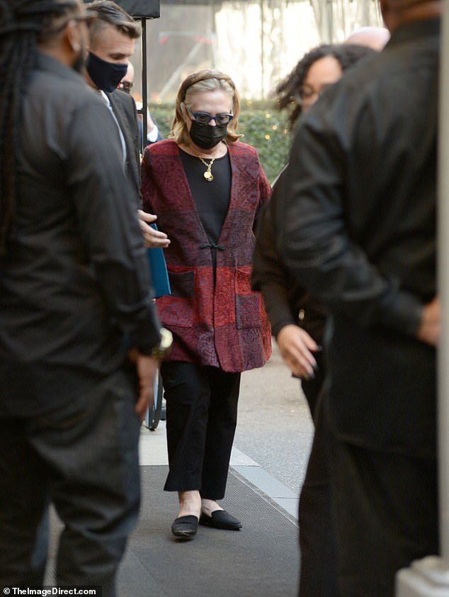 Mrs Clinton appeared to be taking advantage of the warm fall weather in New York and decided to eat outdoors